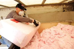 Worker Prepares Owens Corning Blown-In Insulation for Installation